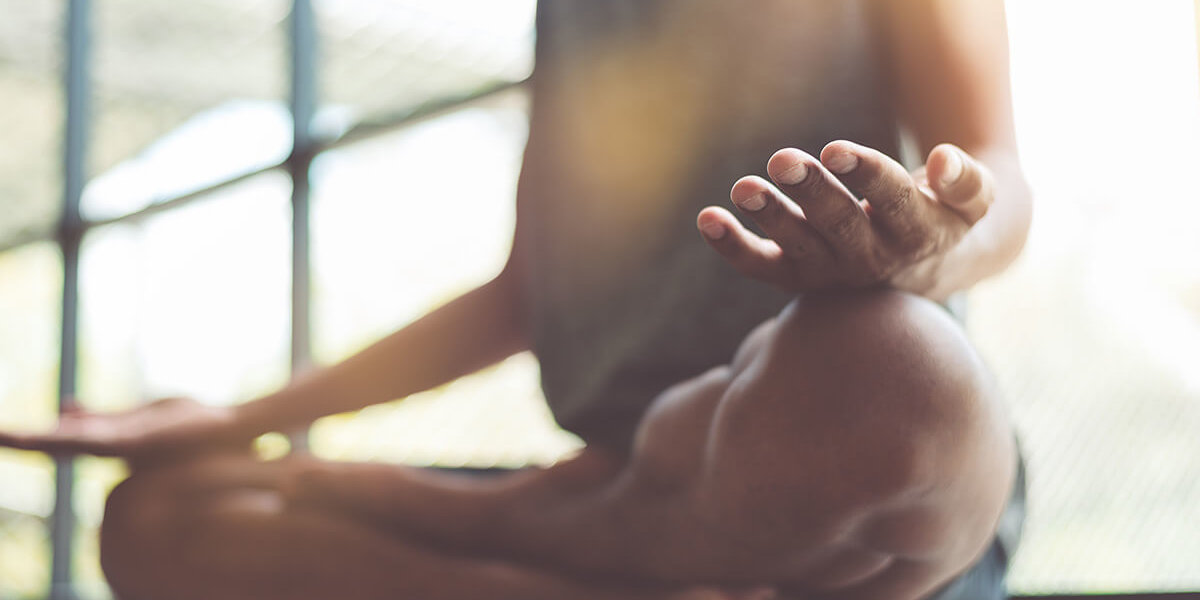 Woman doing yoga knows what is holistic therapy